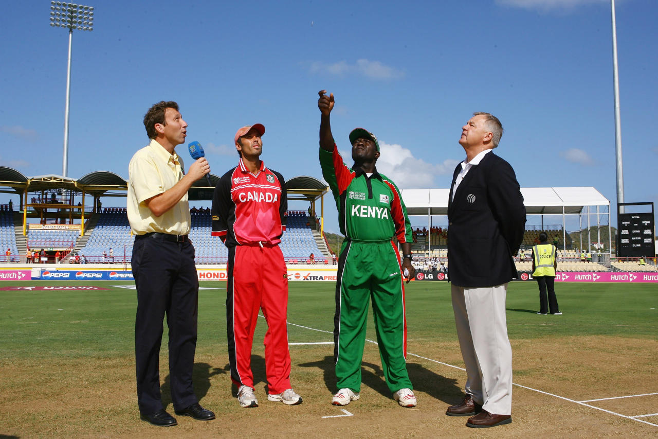 Kenyan captain Steve Tikolo tosses the coin watched by commentator Mike Atherton (L), Canadian captain John Davison and match referee Mike Procter during the ICC Cricket World Cup Group C match between Canada and Kenya at the Beausejour Cricket Ground on March 14, 2007 in Gros Islet, Saint Lucia.  (Photo by Clive Mason/Getty Images)