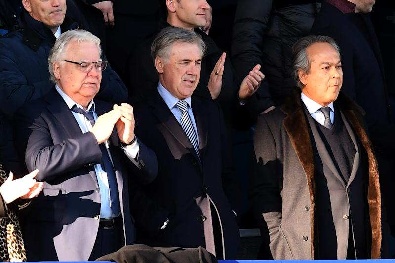 Everton's Italian head coach Carlo Ancelotti (C), Everton's English chairman Bill Kenwright (L) and Everton's Iranian owner Farhad Moshiri look on at the English Premier League football match between Everton and Arsenal at Goodison Park in Liverpool, north west England on December 21, 2019. (Photo by Paul ELLIS / AFP) / RESTRICTED TO EDITORIAL USE. No use with unauthorized audio, video, data, fixture lists, club/league logos or 'live' services. Online in-match use limited to 120 images. An additional 40 images may be used in extra time. No video emulation. Social media in-match use limited to 120 images. An additional 40 images may be used in extra time. No use in betting publications, games or single club/league/player publications. / (Photo by PAUL ELLIS/AFP via Getty Images)