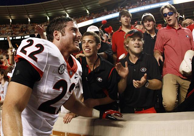 Georgia's Brendan Douglas (22) celebrates with fans after defeating Tennessee 34-31 in overtime of an NCAA college football game on Saturday, Oct. 5, 2013, in Knoxville, Tenn. (AP Photo/Wade Payne)