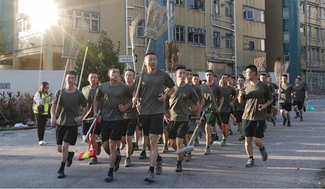 The PLA head back to their barracks in Kowloon Tong. Photo: Edmond So