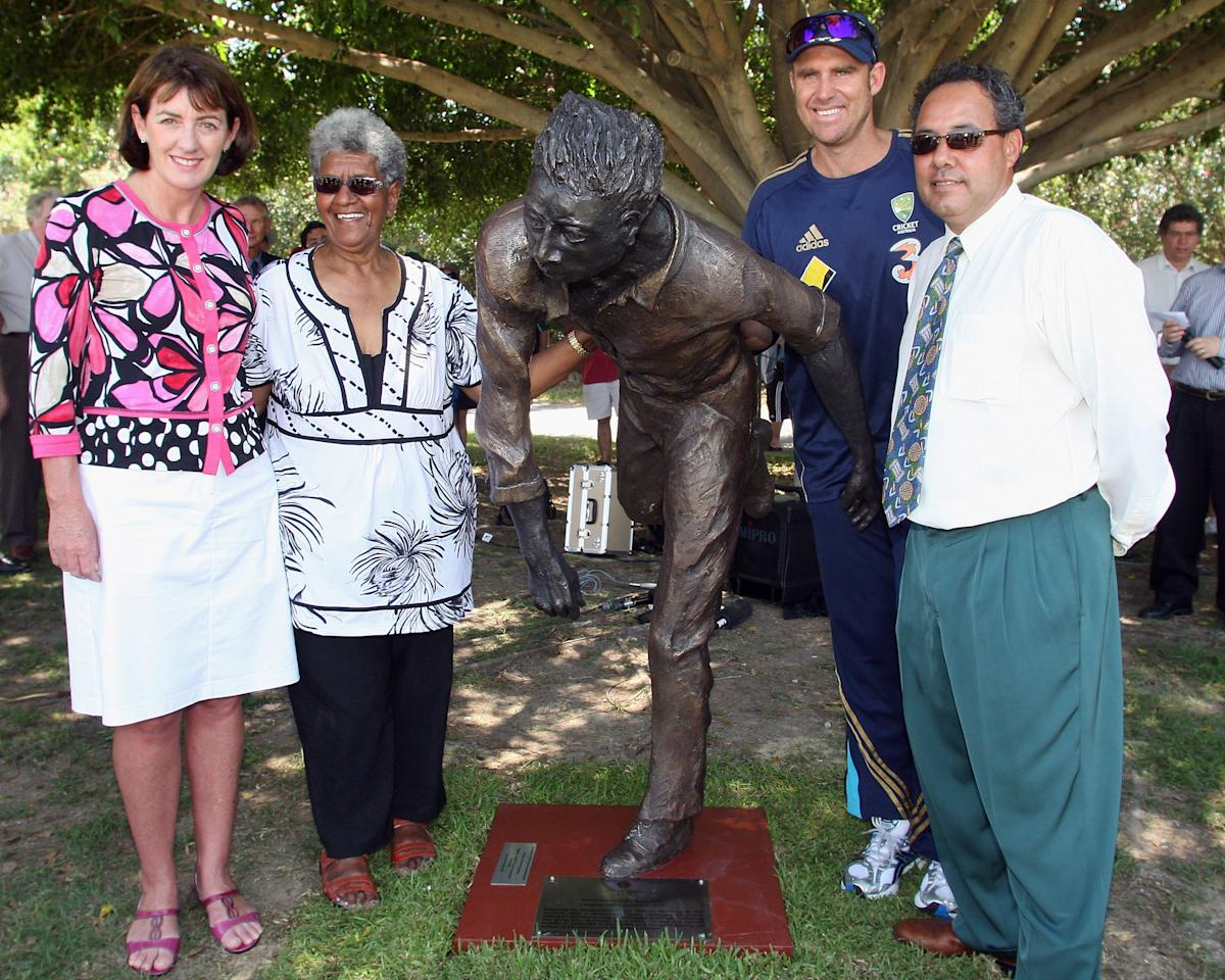 BRISBANE, AUSTRALIA - NOVEMBER 16: (L-R) Judy Spence, Valda Coolwell, Matthew Hayden of Australia and Larry Budd pose after the unveiling of a statue in memory of Indigenious Cricket player Eddie Gilbert during the Cricket All*Star Fan Day, part of the Emirates All*Star Weekend at the Allan Border Field on November 16, 2008 in Brisbane, Australia.  (Photo by Bradley Kanaris/Getty Images)
