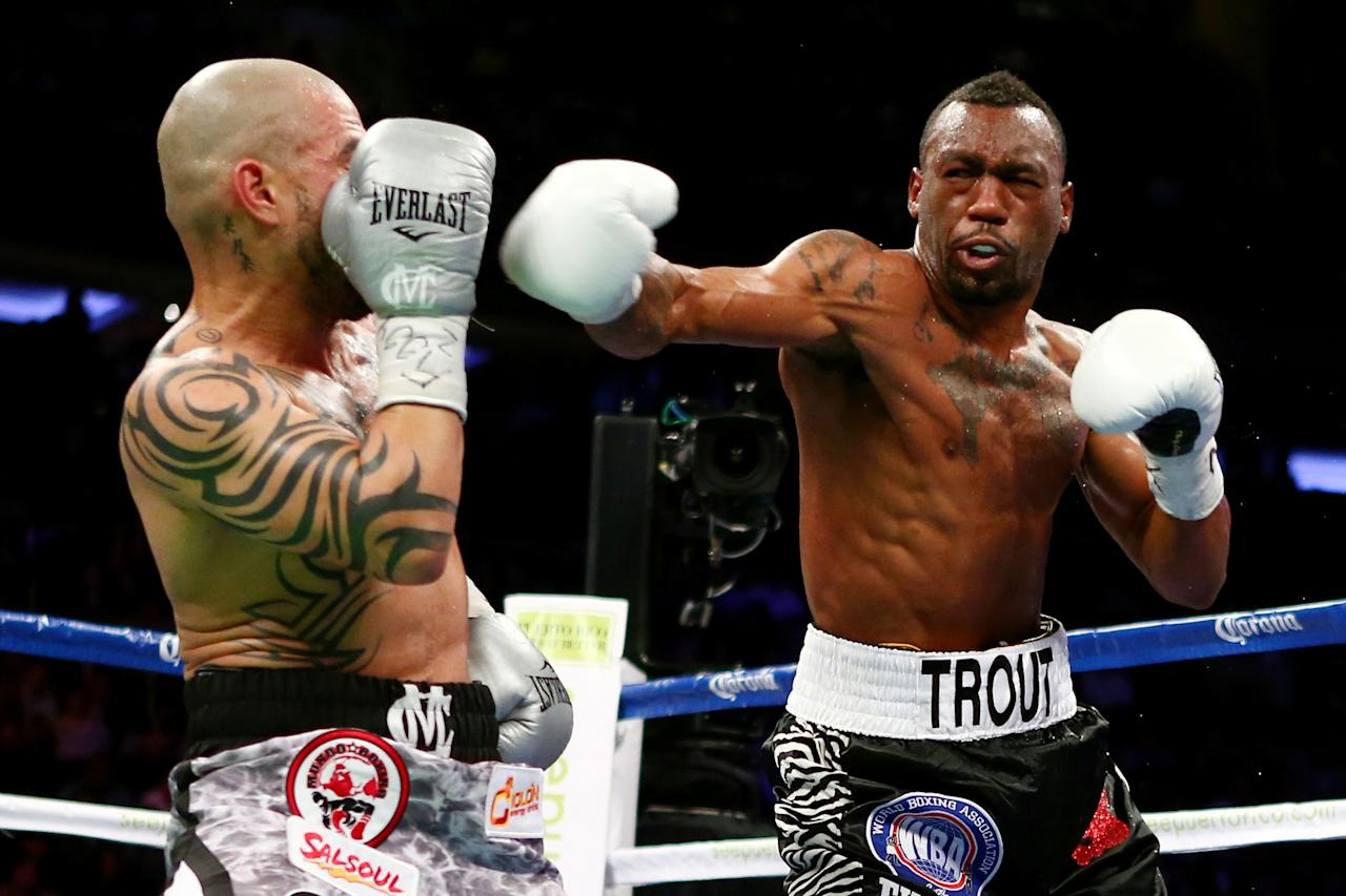 NEW YORK, NY - DECEMBER 01:  Austin Trout  (R) throws a punch against Miguel Cotto in their WBA Super Welterweight Championship title fight at Madison Square Garden on December 1, 2012 in New York City.  (Photo by Elsa/Getty Images)