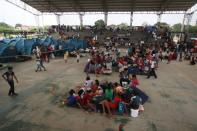 Venezuelan migrants are seen inside a coliseum where a temporary camp has been set up, after fleeing their country due to military operations, according to the Colombian migration agency, in Arauquita