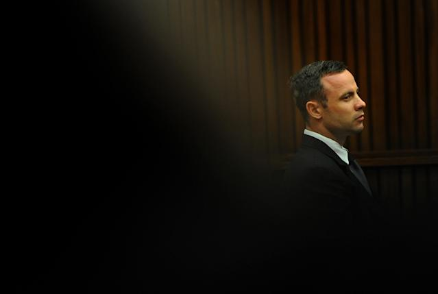 Oscar Pistorius, listens as he sits in the dock waiting for proceedings to begin in court in Pretoria, South Africa, Tuesday, March 18, 2014. Pistorius is on trial for the murder of his girlfriend Reeva Steenkamp on Valentines Day, 2013. (AP Photo/Werner Beukes, Pool)