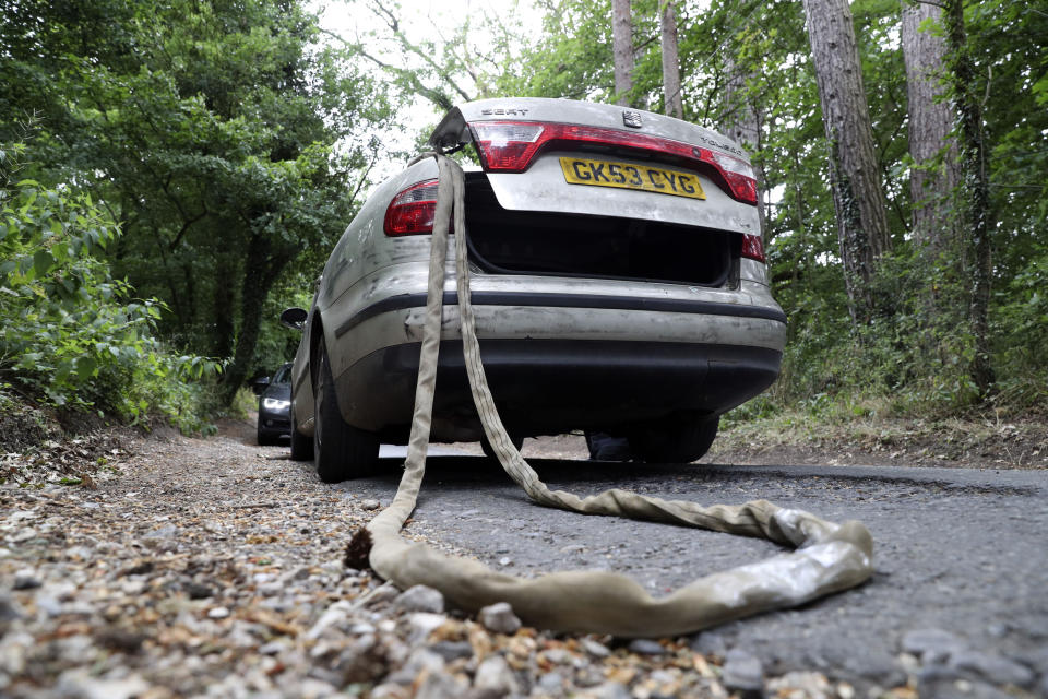 The car with tow rope placed, seen here in a jury reconstruction. (PA Images)