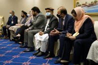 Members of the Islamic Republic of Afghanistan's peace negotiation team attend a meeting with Secretary of State Mike Pompeo amid talks between the Afghan government and the Taliban, Saturday, Nov. 21, 2020, in Doha, Qatar. (AP Photo/Patrick Semansky, Pool)