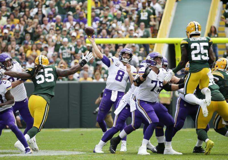FILE - In this Sept. 15, 2019, file photo, Minnesota Vikings quarterback Kirk Cousins throws a pass during the second half of the team's NFL football game against the Green Bay Packers in Green Bay, Wis. Cousins and the Minnesota Vikings finally have the opportunity to avenge a damaging defeat in Green Bay in the second game of the season. They host the rematch with the Packers, on track for the playoffs with the chance to prevent their chief rival from clinching the division title on their home turf. The Packers won the first meeting 21-16, after Cousins threw a dangerous pass in the fourth quarter that was intercepted in the end zone. (AP Photo/Mike Roemer, File)