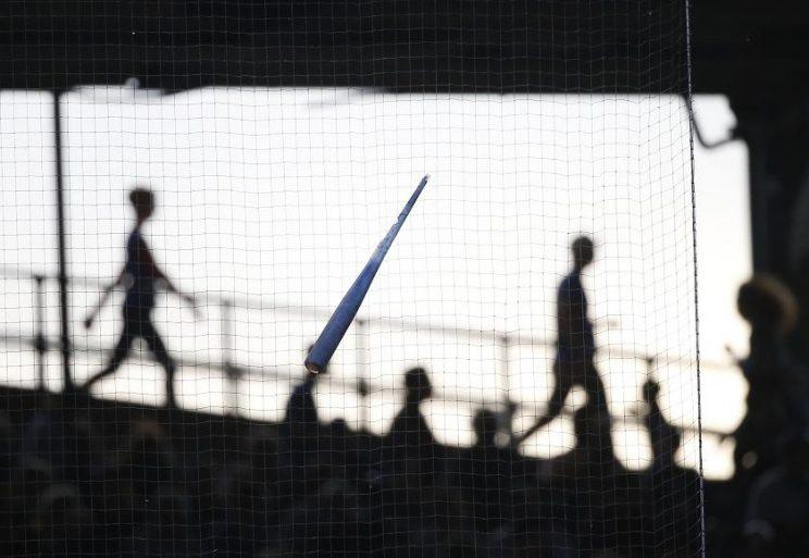 Chicago Cubs' Kris Bryant's bat is lodged in the protective netting after shattering during Bryant's first-inning at-bat against Scott Feldman of the Reds. (AP)