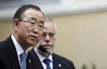 United Nations Secretary-General Ban Ki-moon (L) speaks as he is flanked by Andrea Riccardi, founder of the Saint Egidio Catholic, during his visit to the Saint Egidio Catholic in Rome, October 17, 2015. REUTERS/Yara Nardi