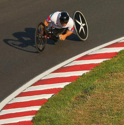LONGFIELD, ENGLAND - SEPTEMBER 08: Alessandro Zanardi of Italyraces in the Mixed H 1-4 Cycling Team Relay on day 10 of the London 2012 Paralympic Games at Brands Hatch on September 8, 2012 in Longfield, England. (Photo by Mike Ehrmann/Getty Images)