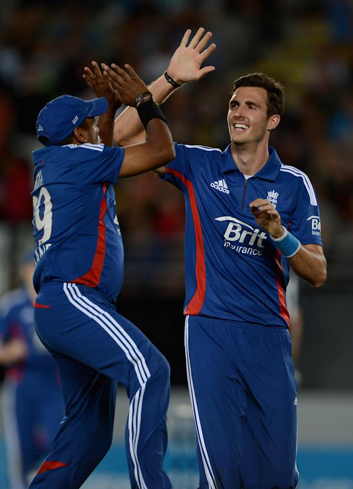 AUCKLAND, NEW ZEALAND - FEBRUARY 09:  Steven Finn of England celebrates with Samit Patel after dismissing Ross Taylor of New Zealand during the 1st T20 International between New Zealand and England at Eden Park on February 9, 2013 in Auckland, New Zealand.  (Photo by Gareth Copley/Getty Images)