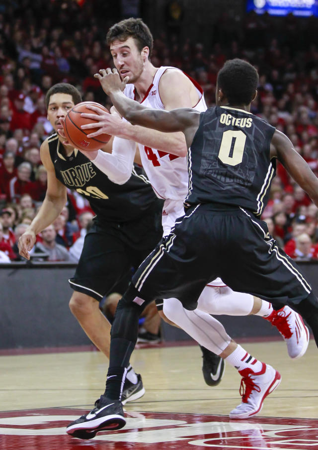 Wisconsin's Frank Kaminsk drive between Purdue's Neal Beshears, left, and Jon Octeus during the second half of an NCAA college basketball game Wednesday, Jan. 7, 2015, in Madison, Wis. Kaminsky had 21 points in Wisconsin's 62-55 win. (AP Photo/Andy Manis)