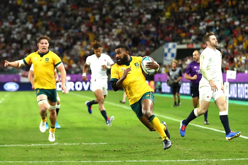 OITA, JAPAN - OCTOBER 19: Marika Koroibete of Australia crosses to score his team's first try as Owen Farrell of England runs in during the Rugby World Cup 2019 Quarter Final match between England and Australia at Oita Stadium on October 19, 2019 in Oita, Japan. (Photo by Michael Steele/Getty Images)