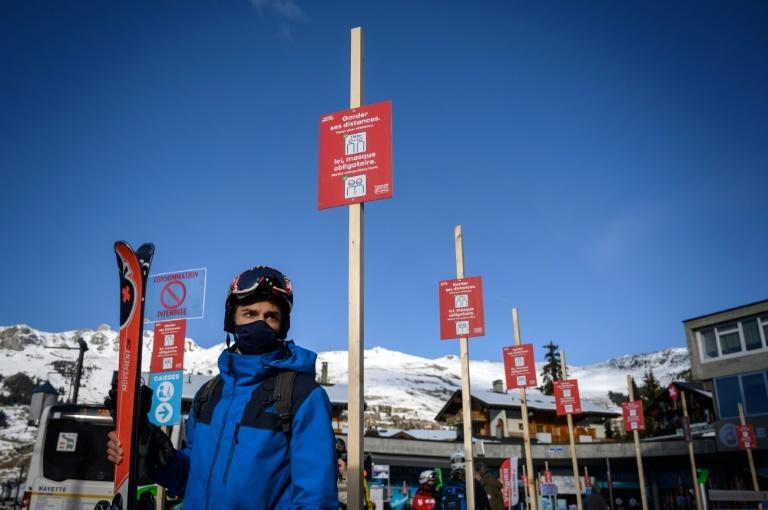 Signs advise those who have made it to the slopes to keep their distance and wear their mask