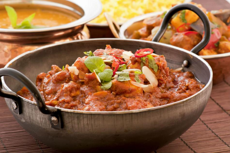 Dig into some delicious Indian food. Here is a kadai of chicken curry made thick and tangy with tomato puree and tempered with fiery red chillies.