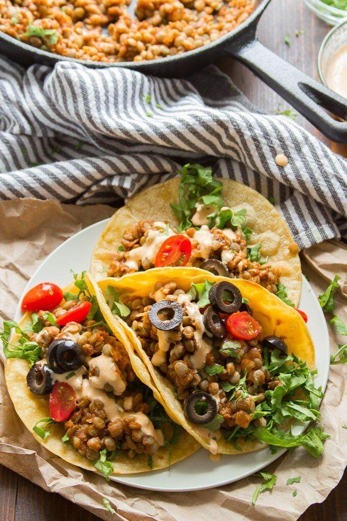 """<a href=""""https://www.connoisseurusveg.com/lentil-tacos/"""" target=""""_blank"""" rel=""""noopener noreferrer""""><strong>Get the Easy Lentil Tacos with Cashew Queso recipe from Connoisseurus Veg.</strong></a>"""