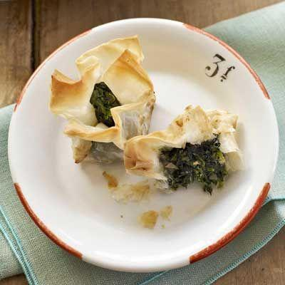 """<p>These snackable bites rely on just a few key ingredients: frozen spinach, phylo dough, and taleggio cheese.</p><p><strong><a href=""""https://www.countryliving.com/food-drinks/recipes/a2790/spinach-taleggio-bites-recipe/"""" rel=""""nofollow noopener"""" target=""""_blank"""" data-ylk=""""slk:Get the recipe"""" class=""""link rapid-noclick-resp"""">Get the recipe</a>.</strong></p>"""