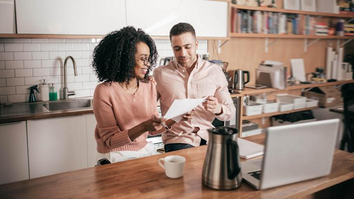 Couple planning their finances on the kitchen.