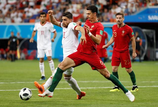 Soccer Football - World Cup - Group B - Iran vs Portugal - Mordovia Arena, Saransk, Russia - June 25, 2018 Portugal's Jose Fonte in action with Iran's Alireza Jahanbakhsh REUTERS/Matthew Childs