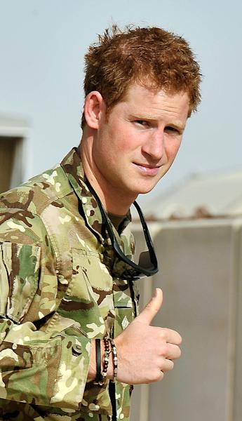Britain's Prince Harry gives a thumbs up Friday Sept. 7, 2012 after he walked past the Apache flight-line at Camp Bastion in Afghanistan, where he will be operating from during his tour of duty as a co-pilot gunner. The Prince has returned to Afghanistan to fly attack helicopters in the fight against the Taliban. (AP Photo/ John Stillwell, Pool)