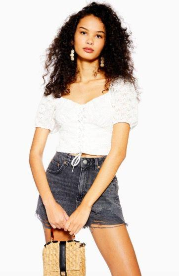 """<p><a class=""""body-btn-link"""" href=""""https://www.topshop.com/en/tsuk/product/clothing-427/floral-lace-up-crop-top-8601752"""" target=""""_blank"""">SHOP NOW</a> £20.00 with student discount</p>"""