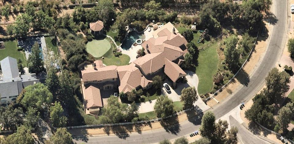 The more than 11,600-square-foot home sits on about 1.5 acres in guard-gated Hidden Hills.