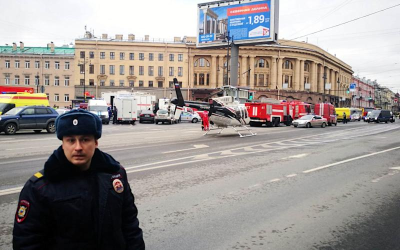 Emergency vehicles and a helicopter are seen at the entrance to - Credit: RUSLAN SHAMUKOV/AFP/Getty Images