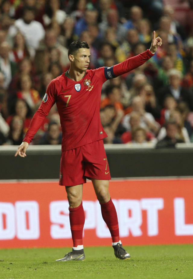Portugal's Cristiano Ronaldo gestures during the Euro 2020 group B qualifying soccer match between Portugal and Ukraine at the Luz stadium in Lisbon, Friday, March 22, 2019. (AP Photo/Armando Franca)