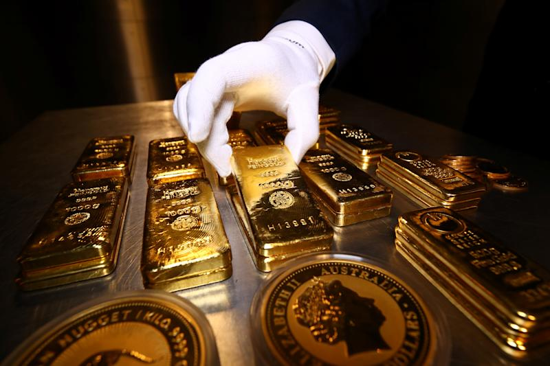 Gold bars and coins are stacked in the safe deposit boxes room of the Pro Aurum gold house in Munich, Germany, August 14, 2019. REUTERS/Michael Dalder