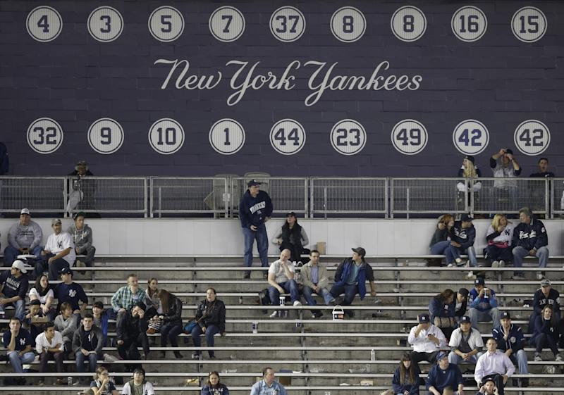 Fans remain for the finals innings of the New York Yankees' 7-0 loss to the Tampa Bay Rays in a baseball game Tuesday, Sept. 24, 2013, in New York. (AP Photo/Kathy Willens)