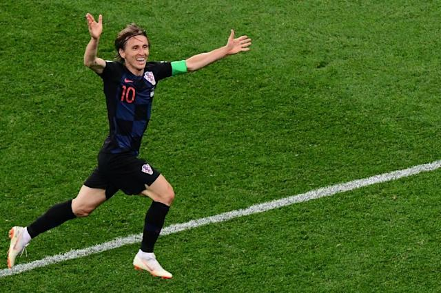 Croatia's midfielder Luka Modric celebrates after scoring (AFP Photo/Martin BERNETTI)