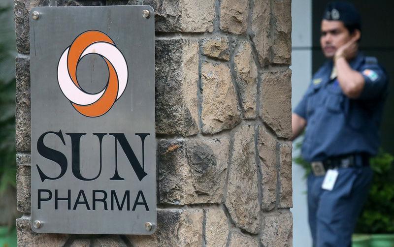 A guard walks inside the office of Sun Pharmaceutical Industries Ltd in Mumbai