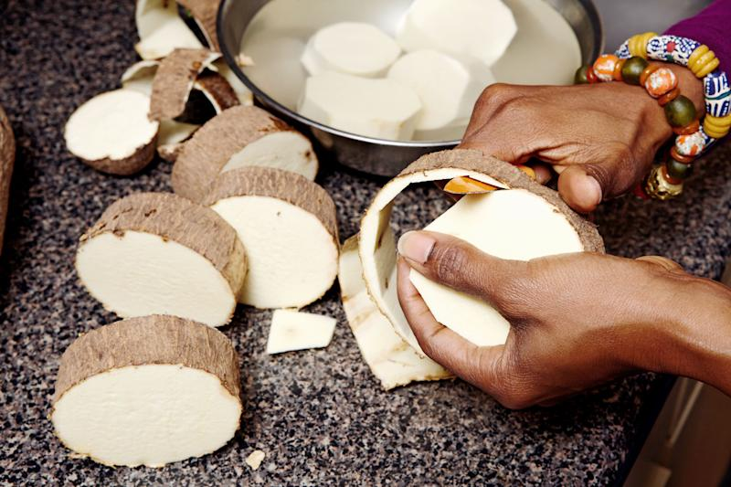 Seriki peels large discs of Ghana yam, which she cubes, steams, and tosses with butter for a simple side dish.