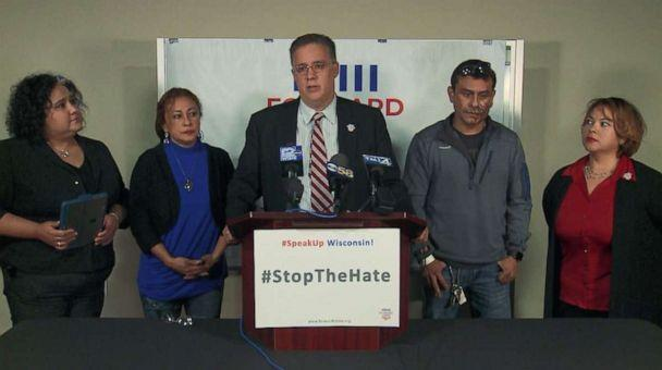 PHOTO: Darryl Morin, president and chairman of the board for Forward Latino, speaks at a press conference Saturday, Nov. 2, 2019, after Mahud Villalaz, second from right, had acid thrown in his face in Milwaukee, Wis. (WISN)