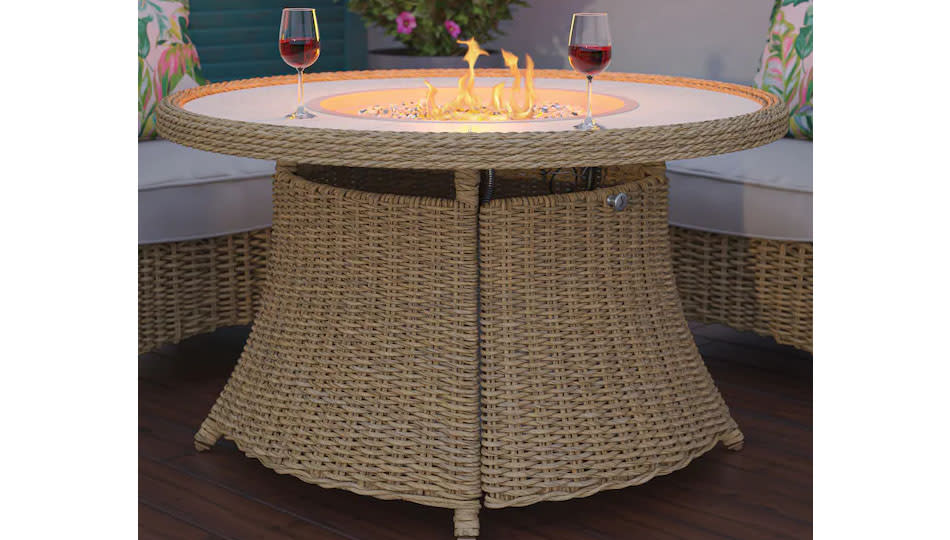 Save big on this backyard-elevating fire table from Lowe's. (Photo: Lowe's)