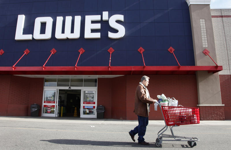 In this Feb. 21, 2012 photo, a customer exits Lowe's, in New York. A private research group says that consumer confidence in February rose to the highest level since a year ago when the U.S. economy's outlook started to look brighter before souring again.  (AP Photo/Mark Lennihan)