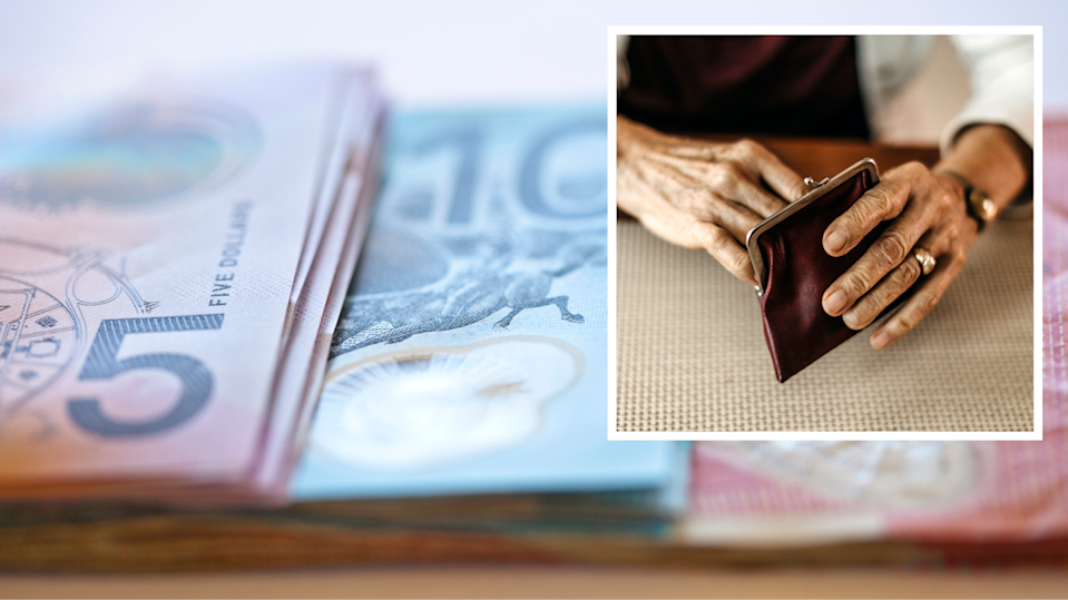 Australian cash. Old woman's hands holding leather purse.