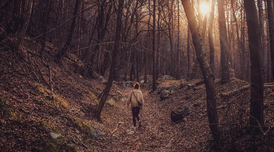 """<p>For most of my adult life, I've taken an after-dinner walk on Thanksgiving. If you live in an area where you feel comfortable walking alone - whether in the woods, at the park, or around the block - I highly recommend it. <a href=""""https://www.popsugar.com/fitness/walking-meditation-to-relax-47366400"""" class=""""link rapid-noclick-resp"""" rel=""""nofollow noopener"""" target=""""_blank"""" data-ylk=""""slk:It's a great time to meditate"""">It's a great time to meditate</a> on all the things you're thankful for, and there's a good chance you'll smell fantastic Thanksgiving dinner smells, delightful chimney smoke, or both. Just be sure to wear a mask and <a href=""""https://www.popsugar.com/fitness/is-it-safe-to-go-outside-while-social-distancing-47338043"""" class=""""link rapid-noclick-resp"""" rel=""""nofollow noopener"""" target=""""_blank"""" data-ylk=""""slk:practice social distancing"""">practice social distancing</a>. </p>"""