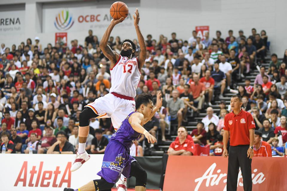 The Singapore Slingers' Jerran Young in action against the CSL Knights Indonesia at the OCBC Arena in Game Two of the 2019 Asean Basketball League Finals.
