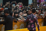 Fans react to Chinese actor Huang Xiaoming at right as he arrives for the 4th Beijing International Film Festival held in Beijing, China, April 16, 2014. Hugely popular online games and celebrity culture are the latest targets in the ruling Communist Party's campaign to encourage China's public to align their lives with its political and economic goals. (AP Photo/Ng Han Guan)