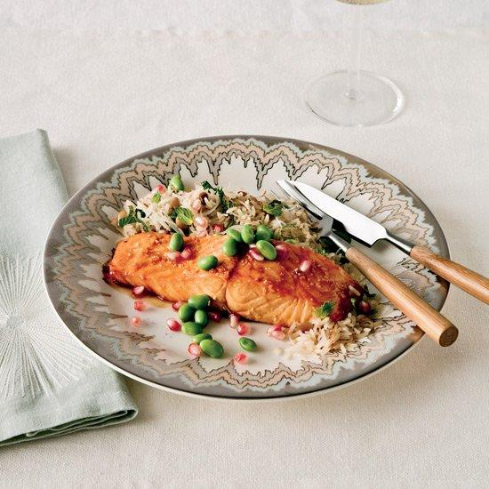 """<p>Shingled slices underneath the salmon impart flavor during roasting; carefully cut supremes come together with the remains of a bunch of parsley to create a tart and bright salad for topping the finished dish.</p><p><a href=""""https://www.foodandwine.com/recipes/pomegranate-glazed-salmon-oranges-olives-and-herbs"""">GO TO RECIPE</a></p>"""