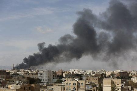 Smoke billows from a site hit by Saudi-led air strikes in Yemen's capital Sanaa