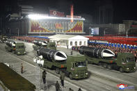 """FILE - This Jan. 14, 2021, file photo provided by the North Korean government shows missiles during a military parade marking the ruling party congress, at Kim Il Sung Square in Pyongyang, North Korea. Last year was a disaster for North Korean leader Kim Jong Un, who helplessly watched his country's economy decay amid pandemic border closures while brooding over the collapse of made-for-TV summits with former President Donald Trump that failed to lift sanctions from his country. Now he must start over with President Joe Biden, who has previously called him a thug and accused Trump of chasing spectacles instead of meaningful reductions of Kim's nuclear arsenal. Korean language watermark on image as provided by source reads: """"KCNA"""" which is the abbreviation for Korean Central News Agency. (Korean Central News Agency/Korea News Service via AP, File)"""