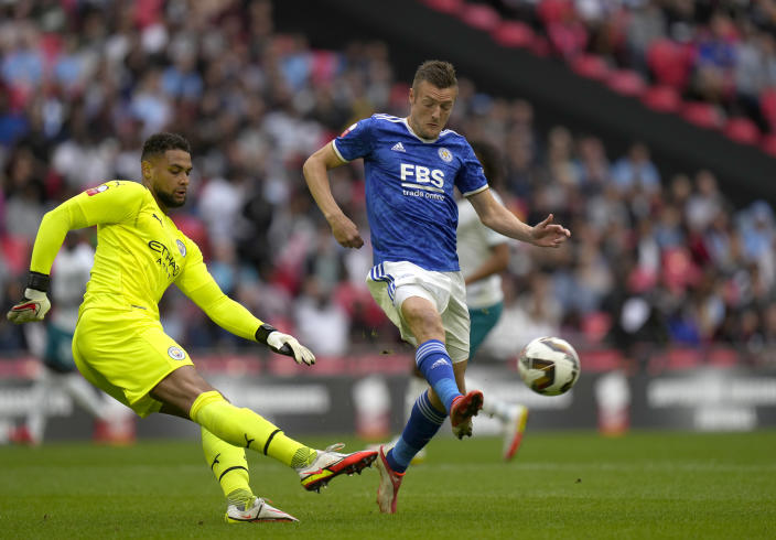 Manchester City's goalkeeper Zack Steffen, left, makes a save in front of Leicester's Jamie Vardy during the English FA Community Shield soccer match between Leicester City and Manchester City at Wembley stadium, in London, Saturday, Aug. 7, 2021. (AP Photo/Alastair Grant)