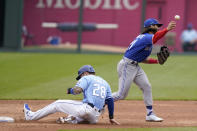 Toronto Blue Jays shortstop Bo Bichette, right, throws to first base after forcing out Kansas City Royals Kyle Isbel, left, during the second inning of a baseball game at Kauffman Stadium in Kansas City, Mo., Sunday, April 18, 2021. (AP Photo/Orlin Wagner)