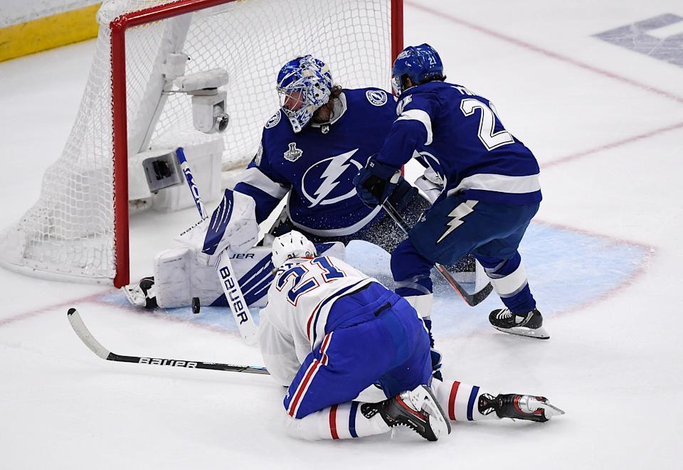 Tampa Bay Lightning goaltender Andrei Vasilevskiy makes a save against Montreal Canadiens center Eric Staal.
