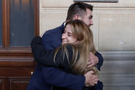 Train host Shauna Asley Verstichelen greets Alek Skarlatos, at the end of their hearing during the Thalys attack trial at the Paris courthouse, Friday, Nov. 20, 2020. Passengers who wrestled and disarmed an Islamic State gunman aboard a high-speed Amsterdam to Paris train are recounting how their split-second decisions helped prevent what could have become a mass slaughter. (AP Photo/Francois Mori)