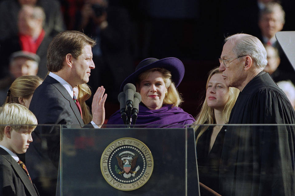 Vice President Al Gore takes the oath of office from Justice Byron White, far right, as his family, Albert III, left, wife Tipper, center, and Karenna, right, watch on the west steps of the Capitol during inauguration ceremonies in Washington, Wednesday, Jan. 20, 1993. (AP Photo/Ron Edmonds)
