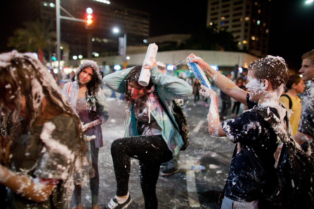 TEL AVIV, ISRAEL - APRIL 15:  (Israel out) Israeli children play with foam spray as Israelis celebrate the Jewish state's 65th Independence Day on April 15, 2013 in Tel Aviv, Israel.  (Photo by Uriel Sinai/Getty Images)