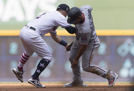 Jul 4, 2018; Milwaukee, WI, USA; Minnesota Twins third baseman Eduardo Escobar (5) is tagged out while attempting to steal second base by Milwaukee Brewers shortstop Nate Orf (2) during the second inning at Miller Park. Mandatory Credit: Jeff Hanisch-USA TODAY Sports